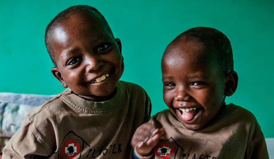Smiling children at Plaster House